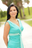 Fashionable woman in the park — Stock Photo