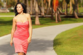 Woman in a dress walking in the park — Stock Photo