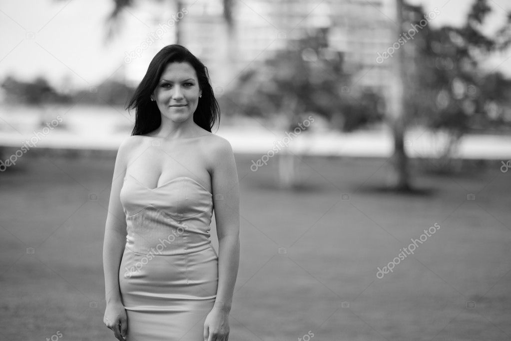 Image of a beautiful female posing in the park  Stock Photo #7456586