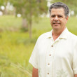 Handsome Cuban man in a tropical park — Stock Photo