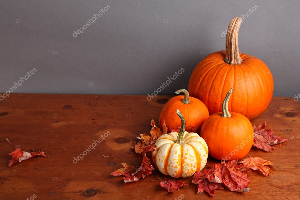 Fall pumpkin and decorative squash with autumn leaves on a wooden table. — Photo #6787419