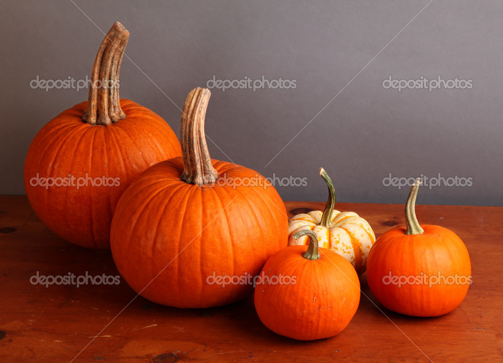 Fall pumpkin and decorative squash with autumn leaves on a wooden table. — Stock Photo #6787479