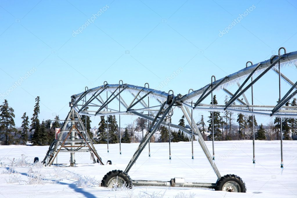 Industrial irrigation equipment on farm field in rural Prince Edward Island, Canada  — Stock Photo #6814320