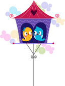 Lovebirds in a Birdhouse — Stock Photo
