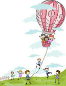 Kids Playing with a Hot Air Balloon — Stock Photo