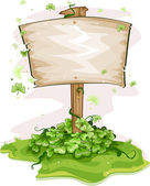 Illustration of a Wooden Board Surrounded by Clovers — Stock Photo