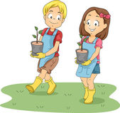 Kids Carrying Seedlings — Stock Photo