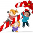 Kids Playing with a Candy Cane — Stock Photo