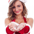 Woman wearing santa claus hat — Stock Photo