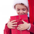 Boy holding a christmas gift — Stock Photo