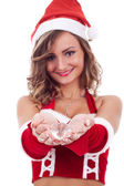 Woman wearing santa claus hat — Stockfoto