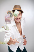 Money flying player — Stock Photo