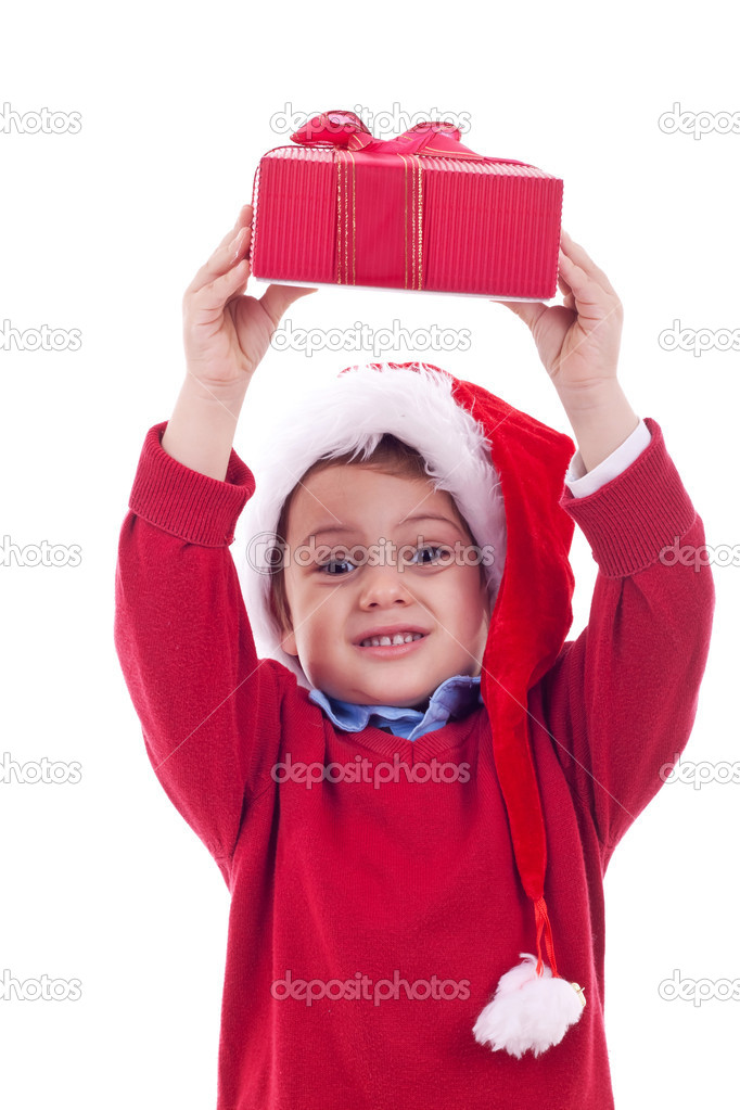 Boy with christmas present over his head, over white  Foto Stock #7232296