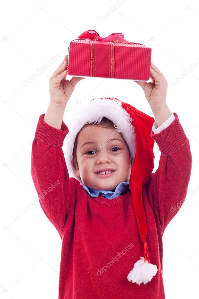 Boy with christmas present over his head, over white — Stok fotoğraf #7232296