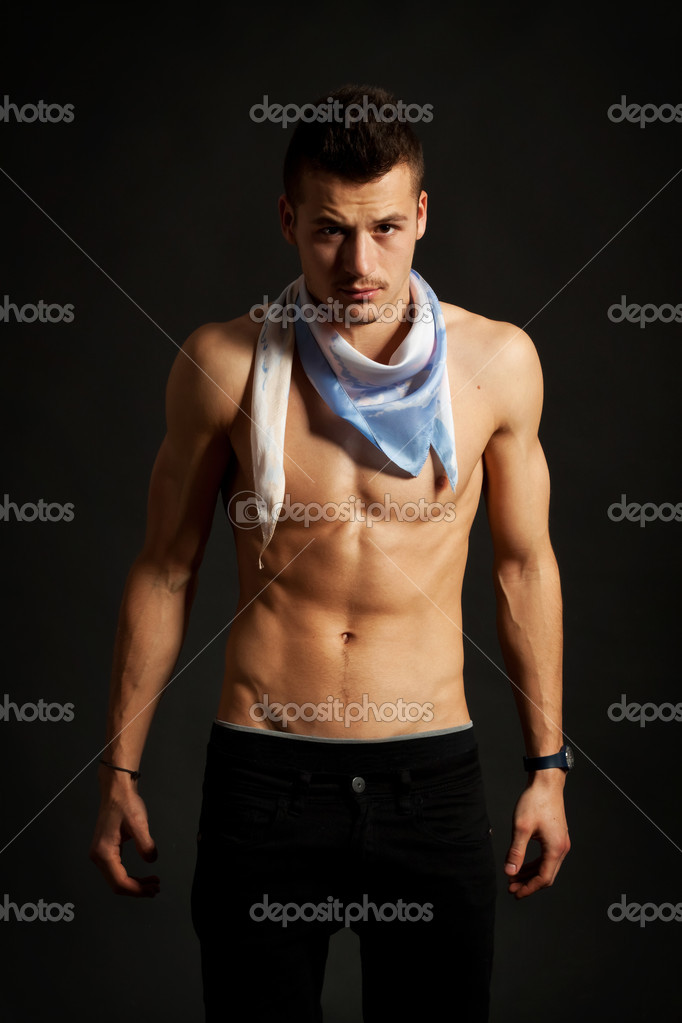 Sexy muscular man wearing a scarf over dark background  — Stock Photo #7232418