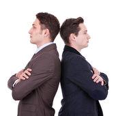 Back to back businessmen — Stock Photo