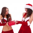 Santa woman giving a present to friend — Stock Photo