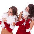 Sexy santa women looking to their side — Stock Photo
