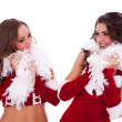 Sexy santa women looking at each other — Stock Photo