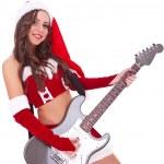 Sexy santa playing an electric guitar — Stock Photo