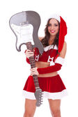Sexy santa holding an electric guitar — Photo
