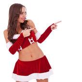指着她身边的性感圣诞老人 — 图库照片