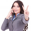 Woman with phone and victory gesture — Stock Photo