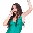 Happy young woman talking to a cell phone — Stock Photo