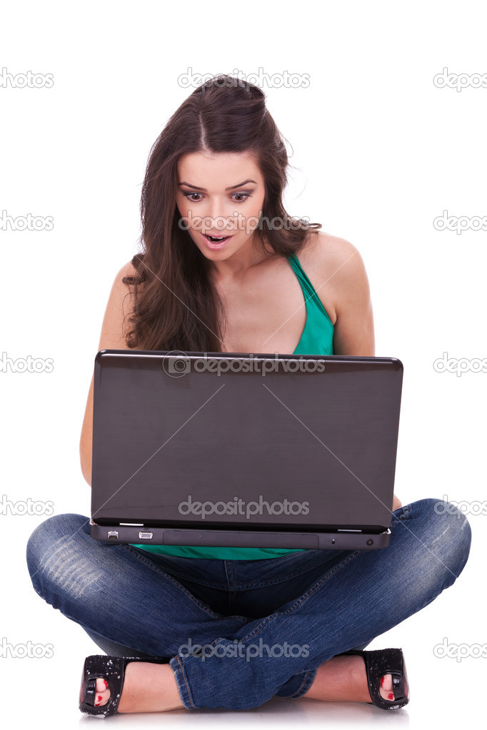 Portrait of an excited college student using laptop against white background  Stock Photo #7692661