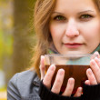 Girl holds large cup with hot tea — Stock Photo