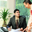 Stock Photo: Two businessmen at office