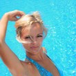 Young woman in a swimming pool — Stock Photo #7266538