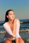 Attractive girl on the beach — Stock Photo
