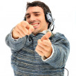 Stock Photo: Young man listening to music