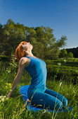 Red woman practicing yoga — Stock Photo