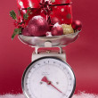 Stock Photo: Christmas decorations on weighing sclaes cost concept