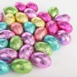 Stock Photo: Colorefd easter eggs over white