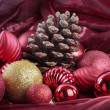 Christmas decorations over red background — Stock Photo #7427577