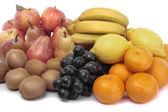 Mixed fruit on basket over white background — Stock Photo