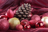Christmas decorations over red background — Stock Photo