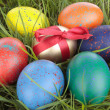 Colored easter  eggs on grass over white — Stock Photo