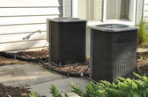 Two outdoor central air conditioner units — 图库照片