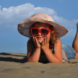 Girls lying in the sand — Stock Photo #7784799