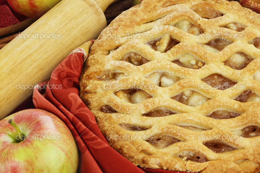 Delicious fresh baked apple pie with rolling pin and ingredients. Perfect for the holidays. — Stock Photo #6851567