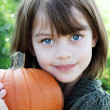 Child Holding a Pumpkin — Stock Photo