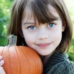Child Holding a Pumpkin — Stock Photo