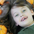 Child Lying in Autumn Leaves — Stock Photo