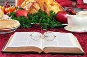Bible and Holiday Dinner — Stock Photo