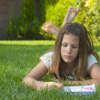Pretty young teenage girl on the grass — Stock Photo