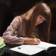 Teenage girl doing her homework. — Stock Photo